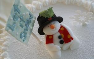 Fondos hd muñeco de nieve como adorno en torta