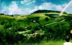 Colinas verdes con arcoiris